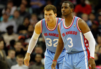 CHARLOTTE, NC - FEBRUARY 11:  Blake Griffin #32 of the Los Angeles Clippers and teammate Chris Paul #3 prepare to play defense against the Charlotte Bobcats during their game at Time Warner Cable Arena on February 11, 2012 in Charlotte, North Carolina. NO
