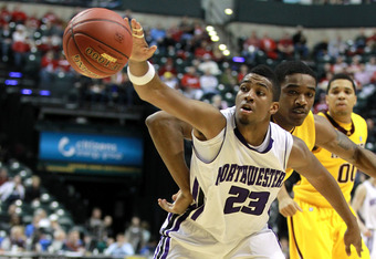 INDIANAPOLIS, IN - MARCH 08:  JerShon Cobb #23 of the Northwestern Wildcats attempts to control the ball against the Minnesota Golden Gophers during their first round game of 2012 Big Ten Men's Basketball Conferene Tournament at Bankers Life Fieldhouse on