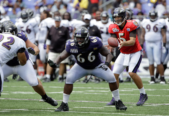 BALTIMORE, MD - AUGUST 06:  Offensive lineman Ben Grubbs #66 of the Baltimore Ravens blocks during training camp at M&T Bank Stadium on August 6, 2011 in Baltimore, Maryland.  (Photo by Rob Carr/Getty Images)