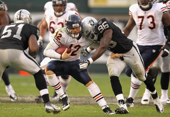 OAKLAND, CA - NOVEMBER 27:  Caleb Hanie #12 of the Chicago Bears is hit by Kamerion Wimbley #96 of the Oakland Raiders at O.co Coliseum on November 27, 2011 in Oakland, California.  (Photo by Ezra Shaw/Getty Images)
