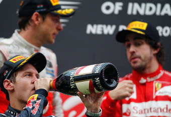 Button & Alonso look on as Vettel savours victory once more