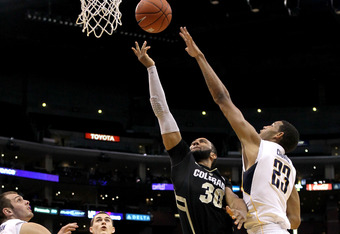 LOS ANGELES, CA - MARCH 09:  Carlon Brown #30 of the Colorado Buffaloes goes up for a shot over Allen Crabbe #23 of the California Golden Bears in the first half in the semifinals of the 2012 Pacific Life Pac-12 men's basketball tournament at Staples Cent