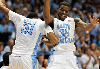 CHAPEL HILL, NC - DECEMBER 21:  John Henson #31 and Reggie Bullock #35 of the North Carolina Tar Heels celebrate during a game against the Texas Longhorns during play at Dean Smith Center on December 21, 2011 in Chapel Hill, North Carolina.  (Photo by Gra