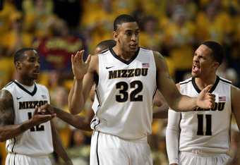 COLUMBIA, MO - FEBRUARY 11:  Michael Dixon #11 of the Missouri Tigers celebrates with Marcus Denmon #12 and Steve Moore #32 after scoring during the game against the Baylor Bears on February 11, 2012  at Mizzou Arena in Columbia, Missouri.  (Photo by Jami