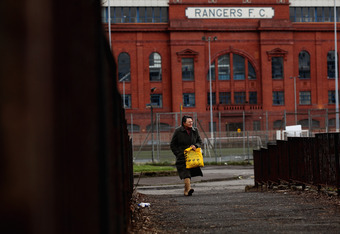 GLASGOW, SCOTLAND - MARCH 08:  A woman walks past Ibrox stadium on March 8, 2012 in Glasgow, Scotland. Rangers administrators Duff and Phelps were at the High Court in London, where a judge has ordered a further hearing on March 30, 2012, in a bid to secu