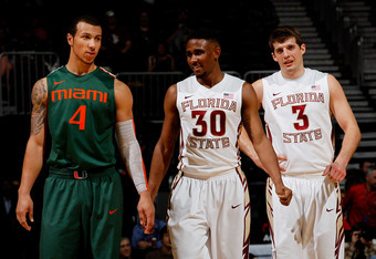ATLANTA, GA - MARCH 09:  (L-R) Trey McKinney Jones #4 of the Miami Hurricanes walks up court along side Ian Miller #30 and Luke Loucks #3 of the Florida State Seminoles in their Quarterfinal game of the 2012 ACC Men's Basketball Conferene Tournament at Ph
