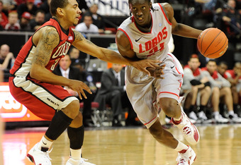 LAS VEGAS, NV - MARCH 09:  Tony Snell #21 of the New Mexico Lobos drives against Anthony Marshall #3 of the UNLV Rebels during a semifinal game of the Conoco Mountain West Conference Basketball tournament at the Thomas & Mack Center March 9, 2012 in Las V