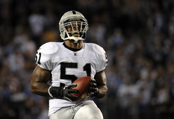 SAN DIEGO, CA - NOVEMBER 10:   Linebacker Aaron Curry #51 of the Oakland Raiders reacts in the first quarter as he holds the football while taking on the San Diego Chargers at Qualcomm Stadium on November 10, 2011 in San Diego, California.  (Photo by Harr