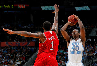 ATLANTA, GA - MARCH 10:  Harrison Barnes #40 of the North Carolina Tar Heels shoots against Richard Howell #1 of the North Carolina State Wolfpack during the semifinals of the 2012 ACC Men's Basketball Conference Tournament at Philips Arena on March 10, 2