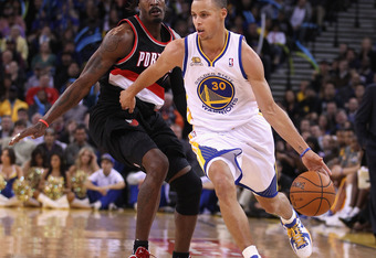 OAKLAND, CA - FEBRUARY 15: Stephen Curry #30 of the Golden State Warriors dribbles past Gerald Wallace #3 of the Portland Trail Blazers at Oracle Arena on February 15, 2012 in Oakland, California. NOTE TO USER: User expressly acknowledges and agrees that,