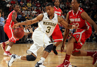 INDIANAPOLIS, IN - MARCH 10:  Trey Burke #3 of the Michigan Wolverines attempts to control the ball against Lenzelle Smith, Jr. #32 of the Ohio State Buckeyes during their Semifinal game of the 2012 Big Ten Men's Basketball Conference Tournament at Banker