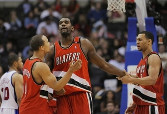 LOS ANGELES, CA - JANUARY 26: Greg Oden #52 of the Portland Trail Blazers celebrates with teammates Brandon Roy #7 and Jerryd Bayless #4 during their game against the Los Angeles Clippers at Staples Center January 26, 2009 in Los Angeles, California. NOTE