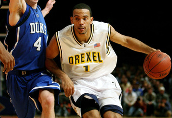 NEW YORK - NOVEMBER 23:  Kenell Sanchez #1 of the Drexel Dragons drives around J.J. Redick #4 of the Duke Blue Devils during their Preseason NIT game at Madison Square Garden on November 23, 2005 in New York City.    (Photo by Nick Laham/Getty Images)