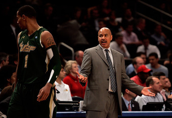 NEW YORK, NY - MARCH 08: head coach Stan Heath talks to Ron Anderson Jr. #1 of the South Florida Bulls after a timeout against the Notre Dame Fighting Irish during the quarterfinals of the Big East Men's Basketball Tournament at Madison Square Garden on M