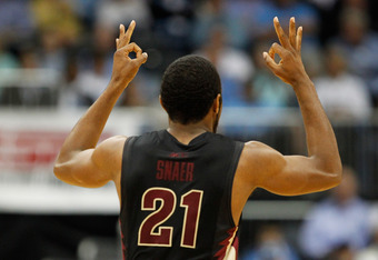 ATLANTA, GA - MARCH 10:  Michael Snaer #21 of the Florida State Seminoles celebrates after making a three-pointer against the Florida State Seminoles in the second half during the semifinals of the 2012 ACC Men's Basketball Conferene Tournament at Philips