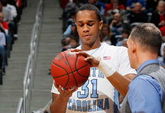 ATLANTA, GA - MARCH 09:  John Henson #31 of the North Carolina Tar Heels talks to Head Athletic Trainer Chris Hirth after being injured in the first half against the Maryland Terrapins during the Quarterfinals of the 2012 ACC Men's Basketball Conferene To