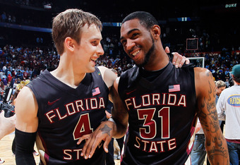 ATLANTA, GA - MARCH 10:  Deividas Dulkys #4 and Terry Whisnant #31 of the Florida State Seminoles celebrate their 62 to 59 win over the Duke Blue Devils during the semifinals of the 2012 ACC Men's Basketball Conferene Tournament at Philips Arena on March
