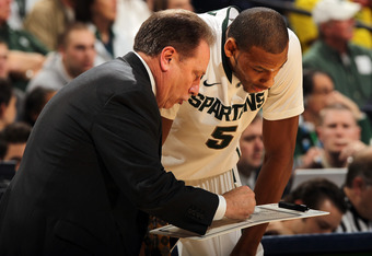 INDIANAPOLIS, IN - MARCH 10:  Head coach Tom Izzo of the Michigan State Spartans talks with Adreian Payne #5 against the Wisconsin Badgers during their Semifinal game of the 2012 Big Ten Men's Basketball Conference Tournament at Bankers Life Fieldhouse on