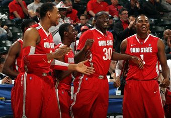 INDIANAPOLIS, IN - MARCH 10:  Jared Sullinger #0, Evan Ravenel #30 and Deshaun Thomas #1 of the Ohio State Buckeyes celebrate on the bench against the Michigan Wolverines during their Semifinal game of the 2012 Big Ten Men's Basketball Conference Tourname