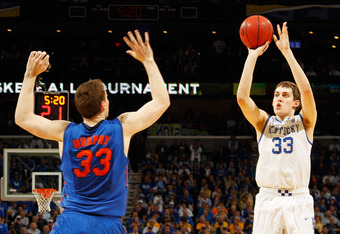 NEW ORLEANS, LA - MARCH 10:  Kyle Wiltjer #33 of the Kentucky Wildcats shoots over Erik Murphy #33 of the Florida Gators in the first half during the semifinals of the SEC Men's Basketball Tournament at New Orleans Arena on March 10, 2012 in New Orleans,