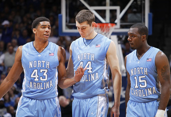 LEXINGTON, KY - DECEMBER 3: James Michael McAdoo #43, Tyler Zeller #44 and P.J. Hairston #15 of the North Carolina Tar Heels talk over strategy during the game against the Kentucky Wildcats at Rupp Arena on December 3, 2011 in Lexington, Kentucky. Kentuck