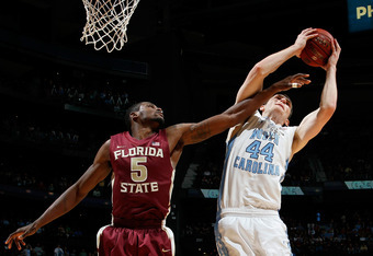 ATLANTA, GA - MARCH 11:  Tyler Zeller #44 of the North Carolina Tar Heels fights for a rebound against Bernard James #5 of the Florida State Seminoles during the Final Game of the 2012 ACC Men's Basketball Conference Tournament at Philips Arena on March 1