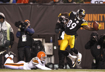 CLEVELAND, OH - JANUARY 01: Wide receiver Jerricho Cotchery #89 of the Pittsburgh Steelers catches a ball in front of defensive back Dimitri Patterson #21 of the Cleveland Browns at Cleveland Browns Stadium on January 1, 2012 in Cleveland, Ohio. (Photo by