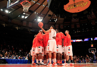 NEW YORK, NY - MARCH 09: The Syracuse Orange huddle before the start of the second half against the Cincinnati Bearcats during the semifinals of the Big East men's basketball tournament at Madison Square Garden on March 9, 2012 in New York City.  (Photo b