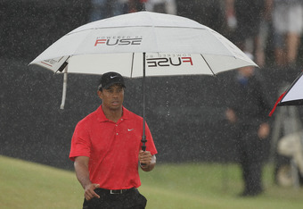 MIAMI, FL - MARCH 11:   Tiger Woods walks off the first tee during the final round of the World Golf Championships-Cadillac Championship on the TPC Blue Monster at Doral Golf Resort And Spa on March 11, 2012 in Miami, Florida.  (Photo by Scott Halleran/Ge