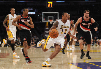 LOS ANGELES, CA - NOVEMBER 07:  Shannon Brown #12 of the Los Angeles Lakers dribbles past Andre Miller #24 and Rudy Fernandez #5 of the Portland Trail Blazers at the Staples Center on November 7, 2010 in Los Angeles, California. The Lakers won 121-96.   N