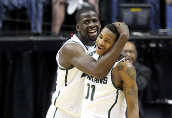 INDIANAPOLIS, IN - MARCH 09:  (L-R) Draymond Green #23 and Keith Appling #11 of the Michigan State Spartans celebrate late in the second half against the Iowa Hawkeyes during their quarterfinal game of 2012 Big Ten Men's Basketball Conferene Tournament at