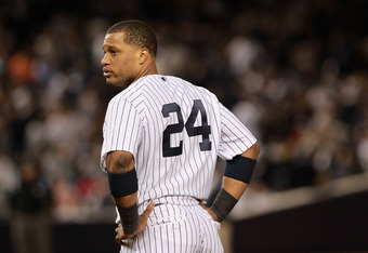 NEW YORK, NY - OCTOBER 06:  Robinson Cano #24 of the New York Yankees looks on against the Detroit Tigers during Game Five of the American League Championship Series at Yankee Stadium on October 6, 2011 in the Bronx borough of New York City. The Tigers wo