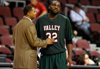 LAS VEGAS, NV - NOVEMBER 25:  Head coach Sean Woods of the Mississippi Valley State Delta Devils talks to Paul Crosby #32 during their game against the Tennessee State Tigers during the third round of the Continental Tire Las Vegas Invitational at the Orl