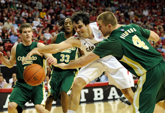 LAS VEGAS, NV - MARCH 09:  (L-R) Jesse Carr #11 and Dwight Smith #33 of the Colorado State Rams defend as Garrett Green #5 of the San Diego State Aztecs is fouled by Pierce Hornung #4 of the Colorado State Rams as they go after a loose ball during a semif