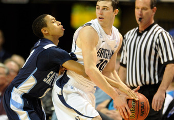 LAS VEGAS, NV - MARCH 02:  Christopher Anderson #0 of the San Diego Toreros tries to steal the ball from Matt Carlino #10 of the Brigham Young Cougars during a quarterfinal game of the Zappos.com West Coast Conference Basketball tournament at the Orleans
