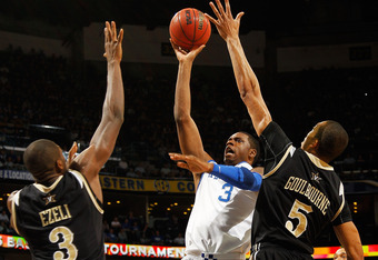 NEW ORLEANS, LA - MARCH 11:  Terrence Jones #3 of the Kentucky Wildcats shoots between Festus Ezeli #3 and Lance Goulbourne #5 of the Vanderbilt Commodores in the first half during the championship game of the 2012 SEC Men's Basketball Tournament at New O