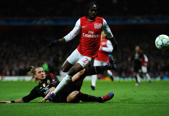 LONDON, ENGLAND - MARCH 06: Philippe Mexes of AC Milan tackles Gervinho of Arsenal during the UEFA Champions League Round of 16 second leg match between Arsenal and AC Milan at Emirates Stadium on March 6, 2012 in London, England.  (Photo by Laurence Grif