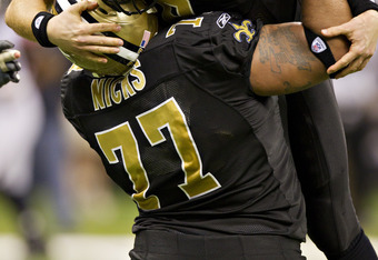 NEW ORLEANS, LA - DECEMBER 26:   Quarterback Drew Brees #9 and Carl Nicks #77 of the New Orleans Saints celebrate after Brees threw a nine-yard touchdown pass to running back Darren Sproles #43 and broke the single-season passing record in the fourth quar
