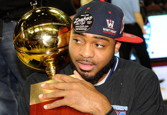 LAS VEGAS, NV - MARCH 05:  Kenton Walker II #30 of the Saint Mary's Gaels holds the trophy after defeating the Gonzaga Bulldogs 78-74 in overtime to win the championship game of the Zappos.com West Coast Conference Basketball tournament at the Orleans Are