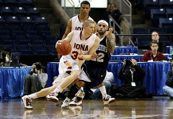 BRIDGEPORT, CT - MARCH 07:  Kyle Smyth #33 of the Iona Gaels drives against Nick Leon #22 of the St. Peter's Peacocks during the final of the MAAC men's conference basketball tournment at Webster Bank Arena at Harbor Yard on March 7, 2011 in Bridgeport, C