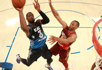 ORLANDO, FL - FEBRUARY 26:  Dwyane Wade #3 of the Miami Heat and and the Eastern Conference attempts a shot against Russell Westbrook #0 of the Oklahoma City Thunder and the Western Conferenceduring the 2012 NBA All-Star Game at the Amway Center on Februa