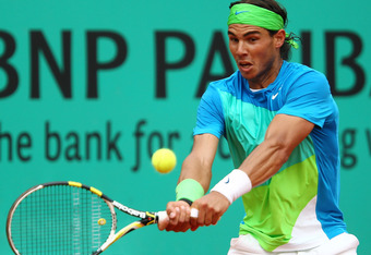 PARIS - JUNE 06:  Rafael Nadal of Spain plays a backhand during the men's singles final match between Rafael Nadal of Spain and Robin Soderling of Sweden on day fifteen of the French Open at Roland Garros on June 6, 2010 in Paris, France.  (Photo by Julia