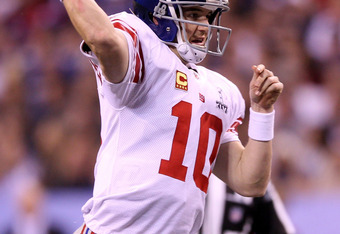 INDIANAPOLIS, IN - FEBRUARY 05:  Eli Manning #10 of the New York Giants in action against the New England Patriots during Super Bowl XLVI at Lucas Oil Stadium on February 5, 2012 in Indianapolis, Indiana.  (Photo by Elsa/Getty Images)