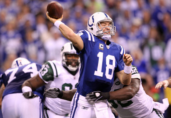 INDIANAPOLIS, IN - JANUARY 08:  Quarterback Peyton Manning #18 of the Indianapolis Colts throws a pss under pressure against the New York Jets during their 2011 AFC wild card playoff game at Lucas Oil Stadium on January 8, 2011 in Indianapolis, Indiana. T