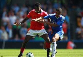 LONDON, ENGLAND - APRIL 10:  Rohan Ince of Chelsea battles with Paul Pogba of Manchester United during the FA Youth Cup Semi Final 1st Leg match between Chelsea and Manchester United at Stamford Bridge on April 10, 2011 in London, England.  (Photo by Dean