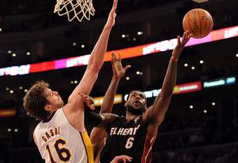 LOS ANGELES, CA - MARCH 04:  LeBron James #6 of the Miami Heat attempts a layup on Pau Gasol #16 of the Los Angeles Lakers during a 93-83 Laker win at Staples Center on March 4, 2012 in Los Angeles, California.  NOTE TO USER: User expressly acknowledges a