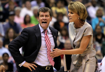 SAN ANTONIO - APRIL 04:  Connecticut Huskies head coach Geno Auriemma is restrained by associate coach Chris Dailey in the second half against the Baylor Bears during the Women's Final Four Semifinals at the Alamodome on April 4, 2010 in San Antonio, Texa