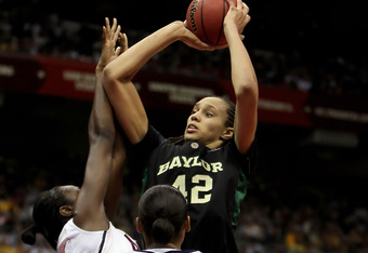 SAN ANTONIO - APRIL 04:  Brittney Griner #42 of the Baylor Bears drives to the basket past Maya Moore #23 of the Connecticut Huskies in the first half during the Women's Final Four Semifinals at the Alamodome on April 4, 2010 in San Antonio, Texas.  (Phot