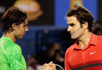 MELBOURNE, AUSTRALIA - JANUARY 26:  Roger Federer of Switzerland and Rafael Nadal of Spain embrace at the net after their semifinal match during day eleven of the 2012 Australian Open at Melbourne Park on January 26, 2012 in Melbourne, Australia.  (Photo