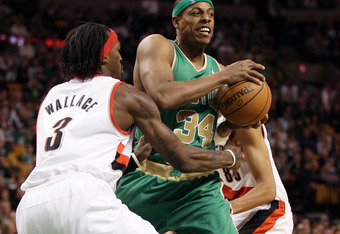 BOSTON, MA - MARCH 09: Paul Pierce #34 of the Boston Celtics tries to get around Gerald Wallace #3 of the Portland Trail Blazers on March 9, 2012 at TD Garden in Boston, Massachusetts. NOTE TO USER: User expressly acknowledges and agrees that, by download